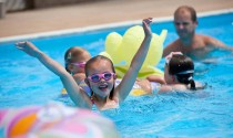 Family swiming in the pool facilities at Beachside Holiday Park in Cornwall