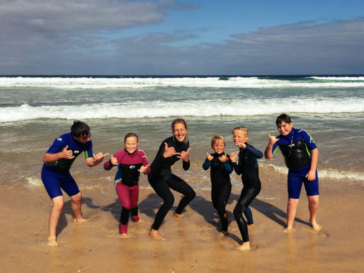 A group enjoying a surfing lesson at Beachside Holiday Park, Hayle, Cornwall