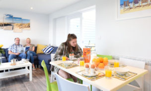 Interior view of new apartment accommodation living room at Beachside Holiday Park, Cornwall